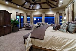 Traditional Master Bedroom with Glass panel door, Exposed beam, Carpet, Ceiling fan, Cathedral ceiling, Wingback settee