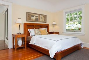 Craftsman Guest Bedroom with Laminate floors, Standard height, double-hung window