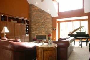 Rustic Living Room with Fireplace, Casement, can lights, Carpet, Built-in bookshelf, Ceiling fan, stone fireplace