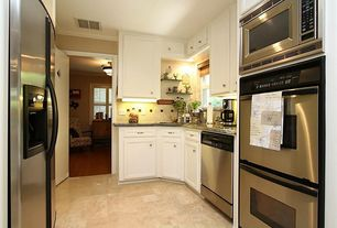 Traditional Kitchen with built-in microwave, Wall sconce, dishwasher, full backsplash, Galley, Simple granite counters