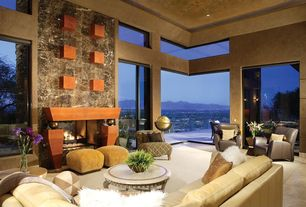 Modern Living Room with sliding glass door, can lights, Fireplace, Carpet, picture window, stone fireplace, High ceiling