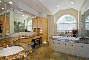 Traditional Master Bathroom with stone tile floors, Undermount sink, can lights, drop in bathtub, European Cabinets, Bathtub