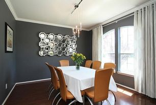 Contemporary Dining Room with Crown molding, Arched window, Pendant light, Laminate floors