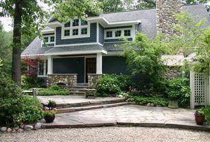 Craftsman Landscape/Yard with Cedar shingle siding, Dormer window, Flagstone, River rock fireplace exterior, River rock