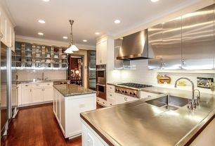 Modern Kitchen with Simple granite counters, Subway Tile, Pendant light, Flush, specialty door, U-shaped, Kitchen island