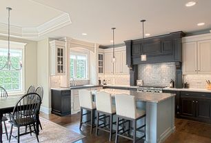 Traditional Kitchen with Custom hood, Hardwood floors, Breakfast bar, Glass panel, Kitchen island, Flush, L-shaped