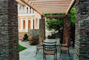 Traditional Patio with Deck Railing, Trellis, Pathway, double-hung window, exterior stone floors, French doors