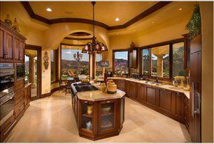 Mediterranean Kitchen with Casement, Pendant light, Breakfast nook, partial backsplash, limestone tile floors, French doors
