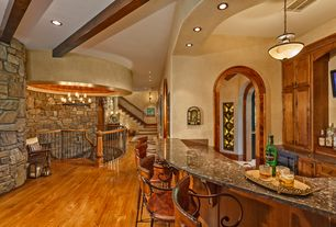 Rustic Bar with Exposed beam, can lights, Hardwood floors, Pendant light, Standard height