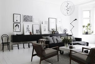 Contemporary Living Room with High ceiling, Design within reach - thonet era chair, Crown molding, Exposed beam, Chandelier