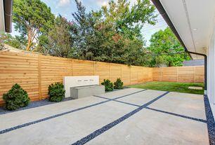Modern Patio with Fountain, exterior tile floors, Fence, Bird bath, Pathway, exterior concrete tile floors