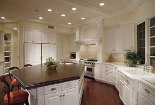 Traditional Kitchen with Simple marble counters, Built-in bookshelf, Raised panel, Undermount sink, Kitchen island
