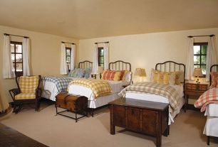 Traditional Guest Bedroom with Antique Chest on Stand, sandstone floors