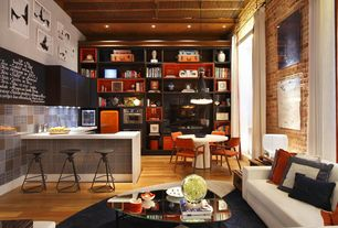 Eclectic Great Room with Pendant light, Standard height, Hardwood floors, interior brick, Built-in bookshelf, can lights