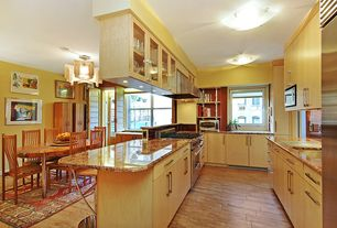 Contemporary Kitchen with European Cabinets, Breakfast nook, Simple granite counters, electric cooktop, Wall Hood, Casement