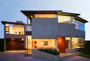 Modern Exterior of Home with Wood garage door, Covered porch, picture window