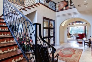 Mediterranean Entryway with can lights, Chandelier, French doors, Crown molding, Loft, High ceiling, Concrete floors