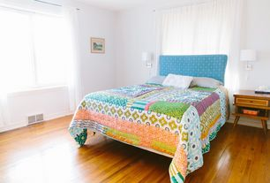 Eclectic Master Bedroom with Wall sconce, Hardwood floors