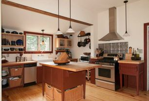 Country Kitchen with Wood counters, Casement, Metal Tile, Glass panel, Exposed beam, Wall Hood, Flat panel cabinets, Flush