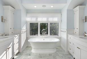Cottage Master Bathroom with stone tile floors, partial backsplash, can lights, Bathtub, Paint, Flat panel cabinets, Casement