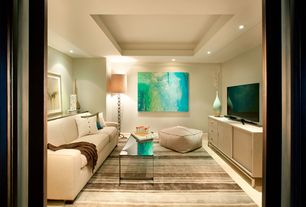 Contemporary Living Room with Box frame coffee table, Laminate floors, Safavieh Mercer Modern Pouf, Henry Sofa