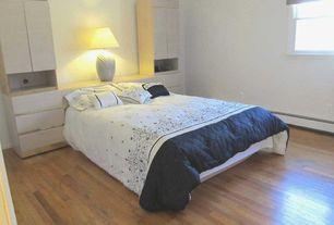 Contemporary Master Bedroom with double-hung window, Hardwood floors, Built-in bookshelf, Standard height