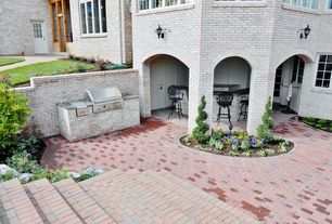 Traditional Patio with French doors, Outdoor kitchen, Pathway, exterior brick floors, Raised beds