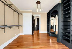 Closet with specialty door, Standard height, Pendant light, Hardwood floors, Crown molding, Built-in bookshelf