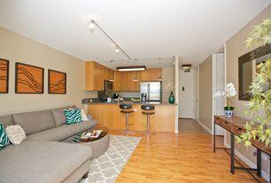 Contemporary Living Room with Laminate floors, flush light
