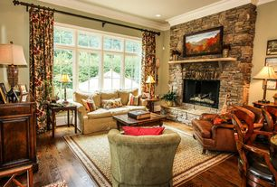 Traditional Living Room with stone fireplace, Hardwood floors, Crown molding