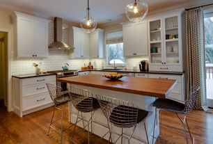 Contemporary Kitchen with Pendant light, Knoll bertoia counter stool with pad, Glass panel, Subway Tile, European Cabinets