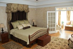 Traditional Master Bedroom with Transom window, Crown molding, Standard height, Hardwood floors, French doors