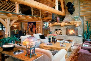 Country Living Room with Loft, Columns, Hardwood floors, Exposed beam, Cathedral ceiling, stone fireplace, Chandelier