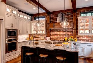 Traditional Kitchen with L-shaped, Hardwood floors, Flagstaff, Inset cabinets, Breakfast bar, Carara white, Stone Tile