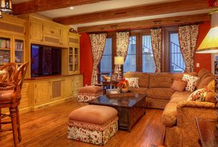 Country Living Room with Exposed beam, Standard height, Hardwood floors, can lights, French doors, Built-in bookshelf