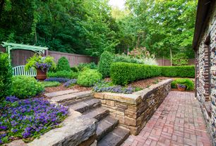 Traditional Landscape/Yard with Fence, Arbor, Pathway, exterior brick floors