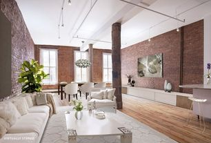Contemporary Great Room with Columns, interior brick, Pendant light, Hardwood floors, Chandelier, Exposed beam