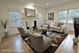 Contemporary Living Room with Hardwood floors, Anna houndstooth grande accent chair, Bubble ceramic side table, Crown molding