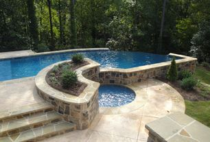 Traditional Swimming Pool with Fence, exterior stone floors, Pathway, Infinity pool, Pool with hot tub, Raised beds