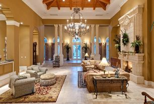 Traditional Living Room with Crown molding, terracotta tile floors, stone fireplace, Columns, Arched window, High ceiling
