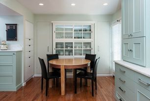 Contemporary Dining Room with Carrara marble countertop, Paint 2, Standard height, can lights, Hardwood floors, Paint 1