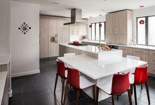 "Modern Kitchen with Limestone counters, Kitchen island, Emser tile spectrum 12"" x 24"" glazed porcelain tile in nashira, Flush"