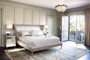 Traditional Master Bedroom with Standard height, Concrete floors, French doors, specialty door, Pendant light, Balcony