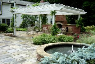 Traditional Patio with exterior stone floors, French doors, Trellis, outdoor pizza oven