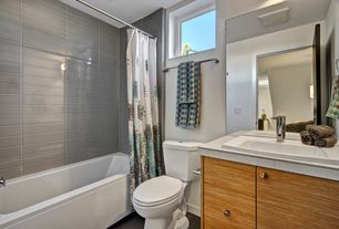 Contemporary Full Bathroom with Simple marble counters, Flush, European Cabinets, Elements Forest 2x12 Glass Subway Tiles