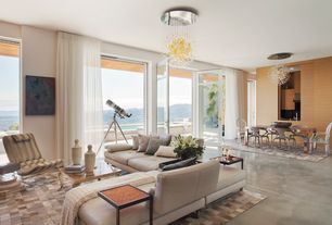 Contemporary Great Room with Concrete floors, interior wallpaper, Chandelier, French doors