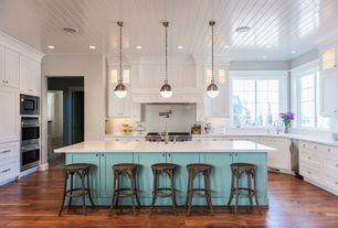 Eclectic Kitchen with Undermount sink, Kitchenaid stand mixer, Hardwood floors, Flat panel cabinets, Limestone counters