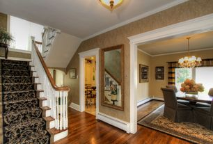 Traditional Staircase with flush light, Hardwood floors, Crown molding