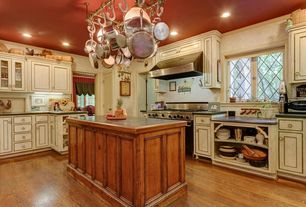 Country Kitchen with Glass panel, L-shaped, Slate counters, Hardwood floors, Kitchen island, Flat panel cabinets, flush light