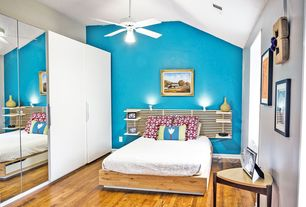 Contemporary Guest Bedroom with Ceiling fan, Wall sconce, Hardwood floors, Built-in bookshelf
